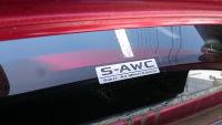 リアウインドウにS-AWCのステッカーを貼った